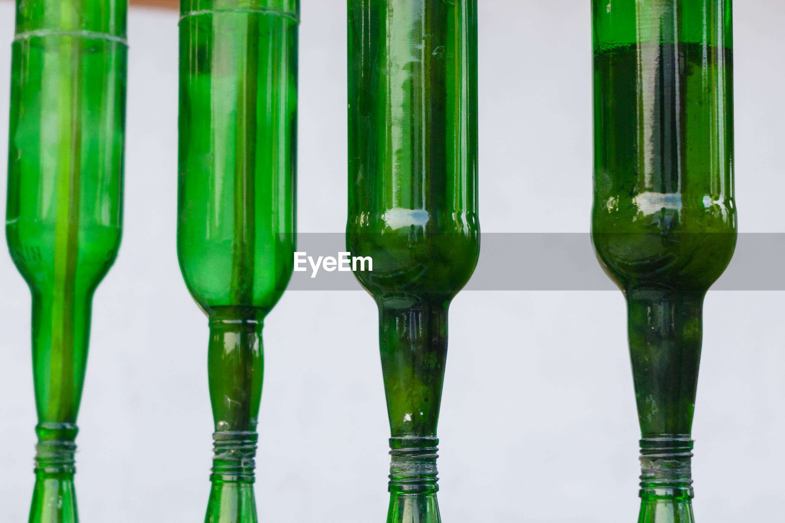 The close-up of green bottle