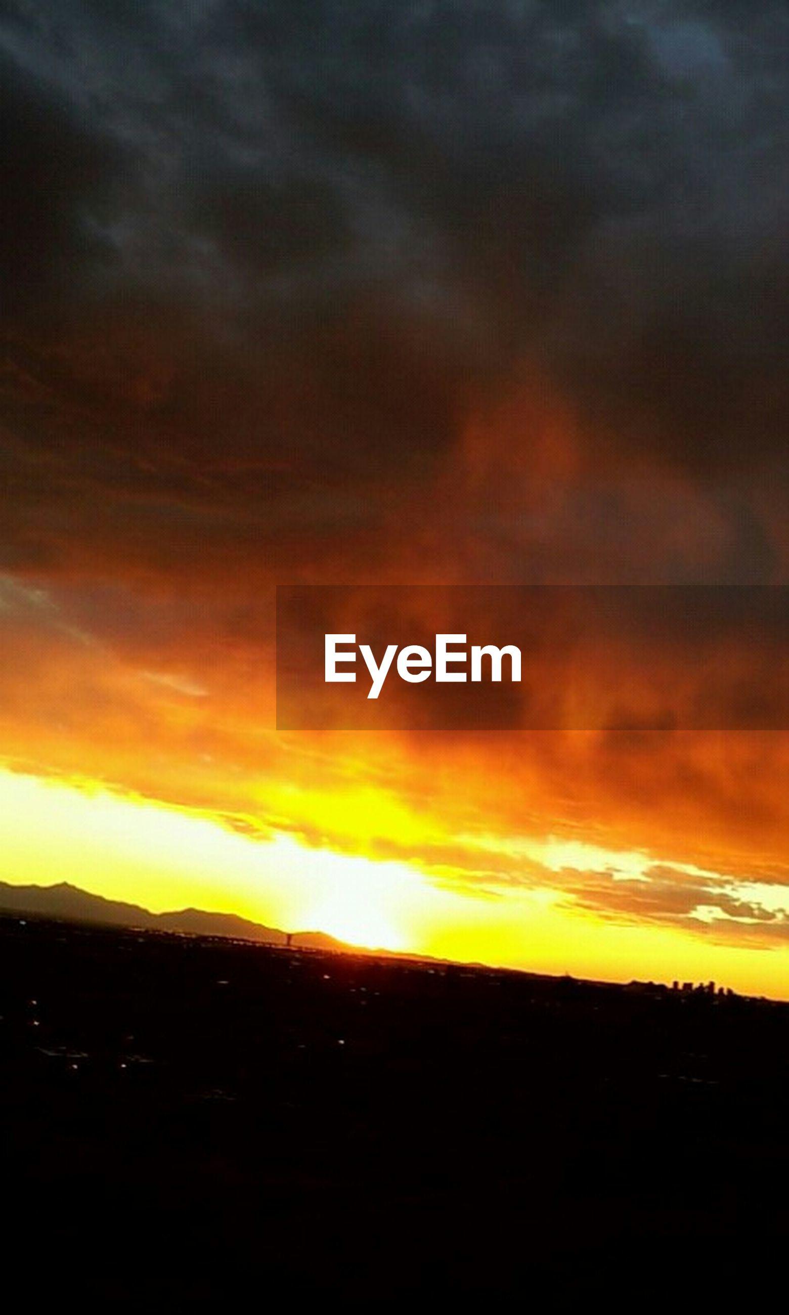 sunset, sky, scenics, orange color, beauty in nature, silhouette, tranquil scene, cloud - sky, tranquility, sun, dramatic sky, landscape, idyllic, nature, cloud, cloudy, moody sky, sunlight, atmospheric mood, outdoors