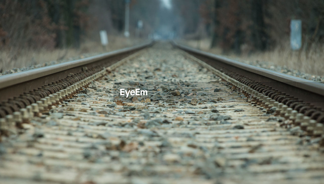 rail transportation, track, railroad track, transportation, the way forward, direction, diminishing perspective, selective focus, no people, vanishing point, surface level, metal, gravel, mode of transportation, close-up, day, outdoors, travel, public transportation, solid, long