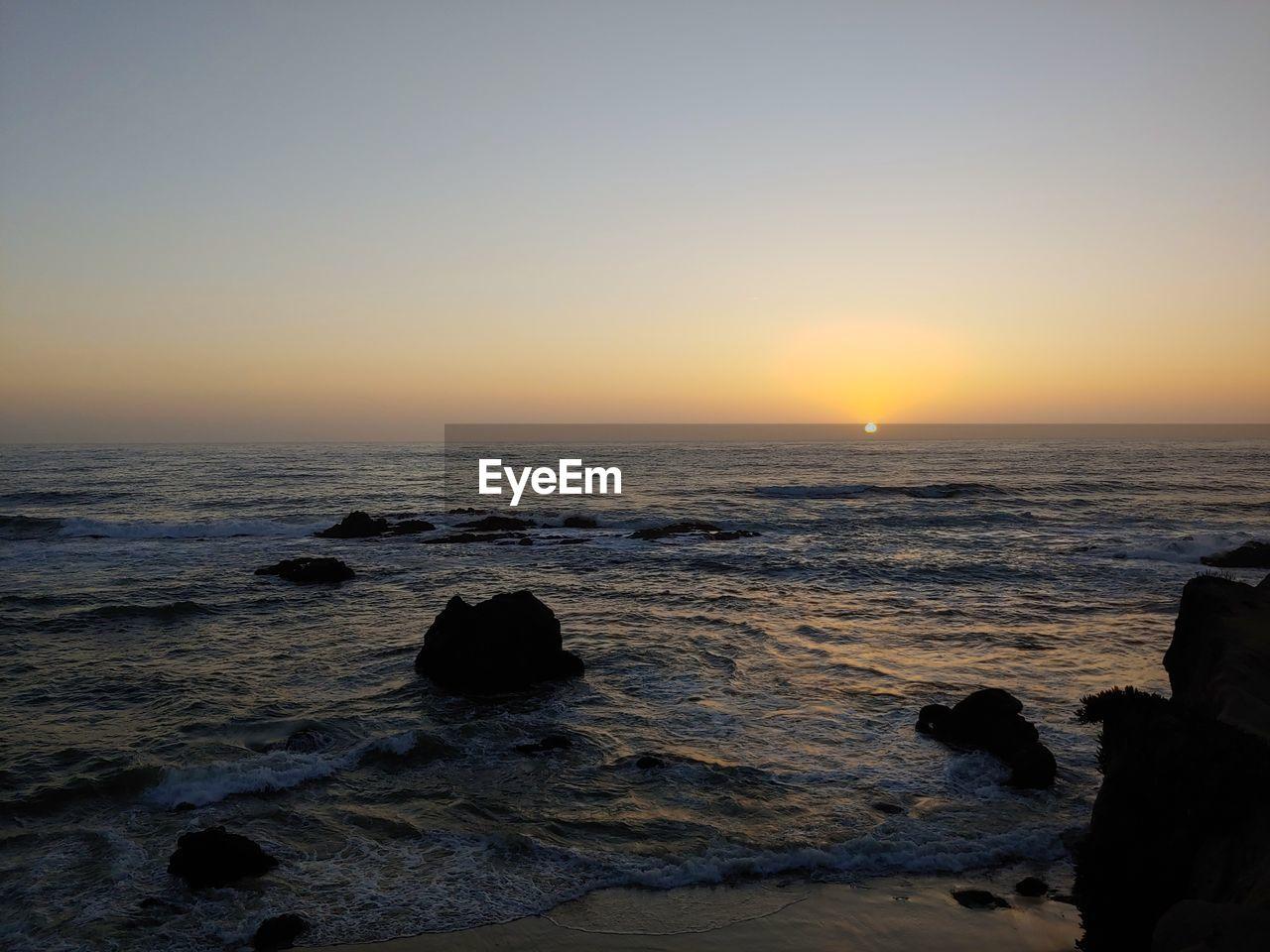 sky, sea, water, sunset, scenics - nature, beauty in nature, beach, horizon over water, rock, horizon, land, motion, wave, rock - object, solid, nature, idyllic, sun, non-urban scene, no people, outdoors