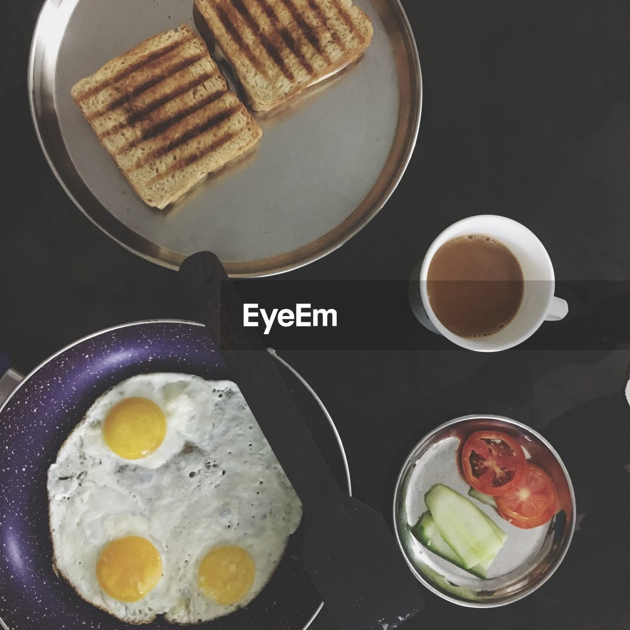 food and drink, food, freshness, meal, kitchen utensil, ready-to-eat, healthy eating, breakfast, still life, indoors, wellbeing, egg, high angle view, no people, refreshment, drink, eating utensil, cup, directly above, table, fried egg, fried, temptation