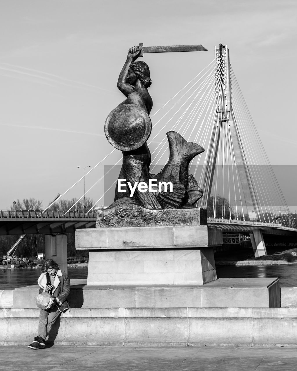 LOW ANGLE VIEW OF STATUE ON BRIDGE