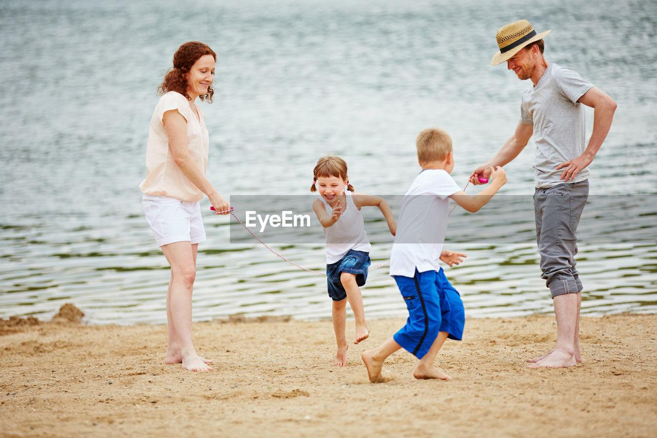 Family Playing At Lakeshore