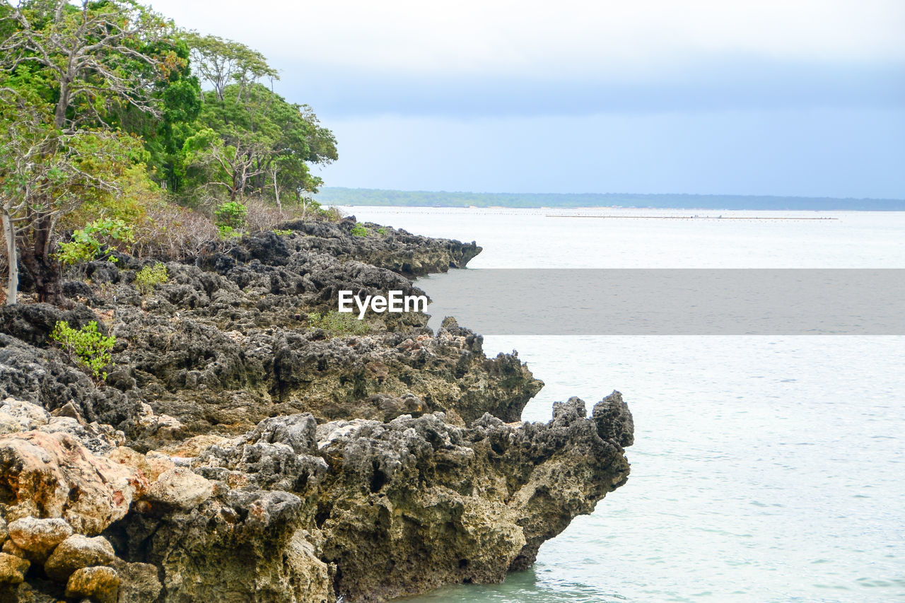 sea, water, beauty in nature, sky, rock, scenics - nature, horizon over water, rock - object, solid, tranquil scene, horizon, tranquility, land, beach, nature, rock formation, no people, day, plant, outdoors, rocky coastline