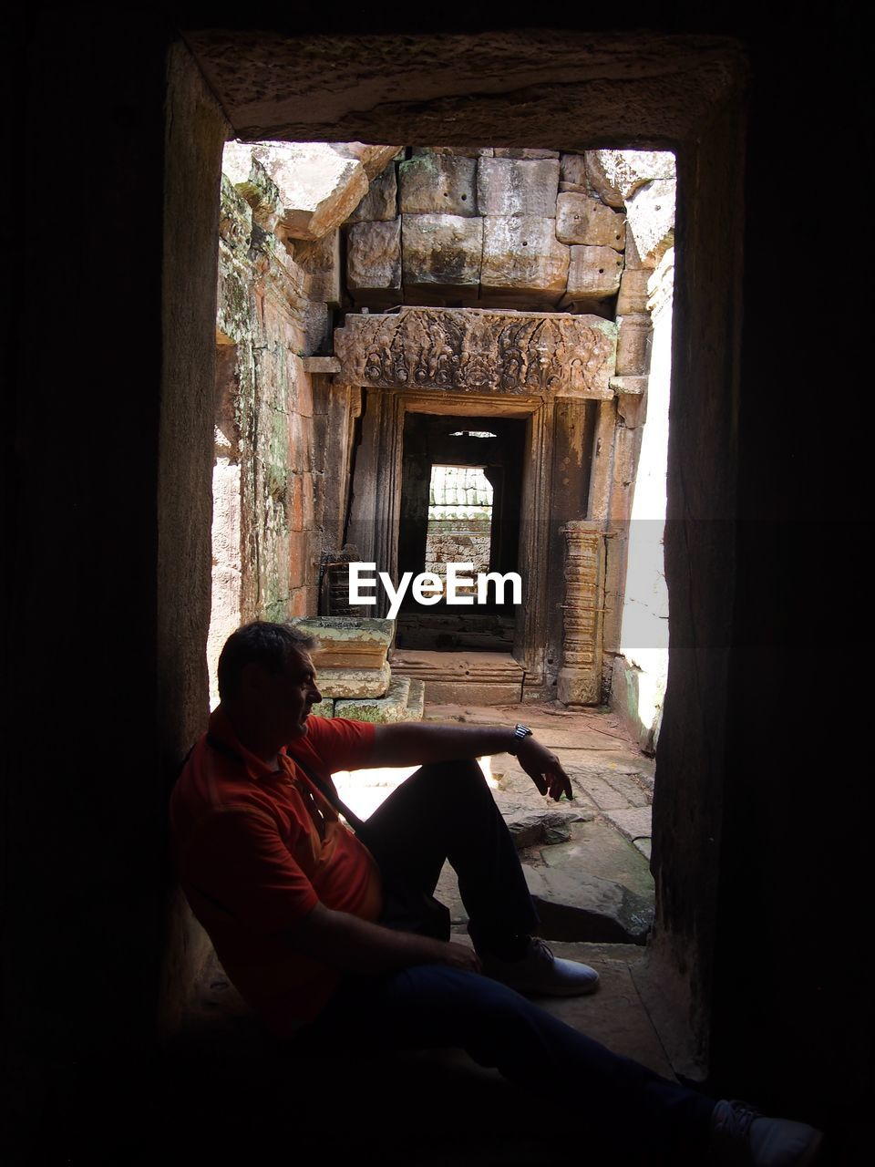 Man Sitting In Old Ruin