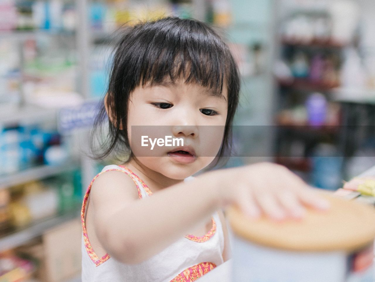 Close-Up Of Cute Girl In Supermarket