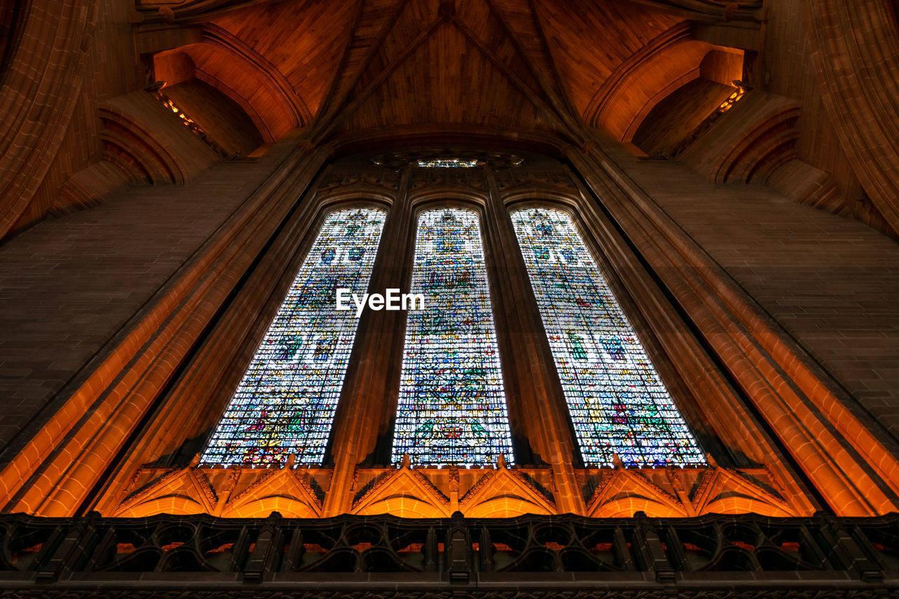 built structure, architecture, religion, low angle view, place of worship, belief, stained glass, spirituality, glass - material, no people, building, building exterior, travel destinations, window, arch, glass, ceiling, ornate