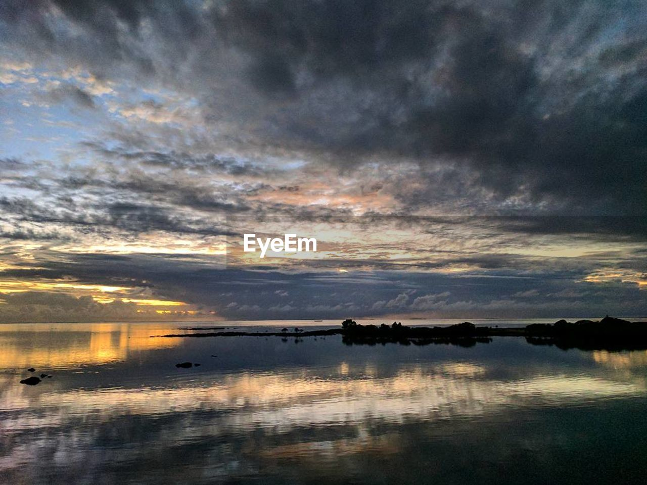 sunset, reflection, cloud - sky, sky, water, beauty in nature, tranquil scene, scenics, tranquility, nature, dramatic sky, silhouette, outdoors, waterfront, no people, lake, nautical vessel, day
