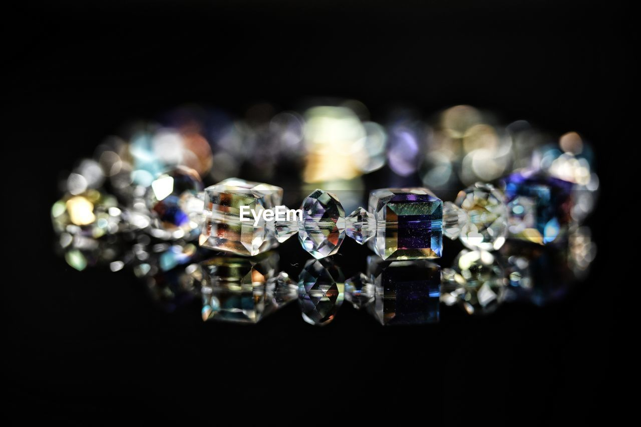 Close-up of jewelry over black background