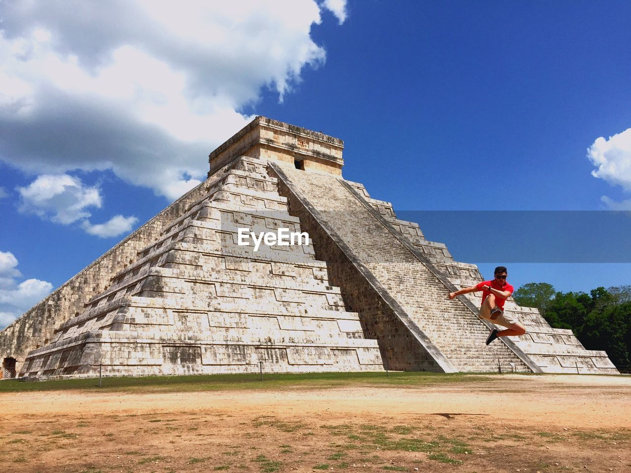 architecture, history, the past, built structure, sky, pyramid, tourism, travel, one person, ancient, travel destinations, nature, real people, cloud - sky, full length, day, lifestyles, building exterior, leisure activity, ancient civilization, archaeology, outdoors