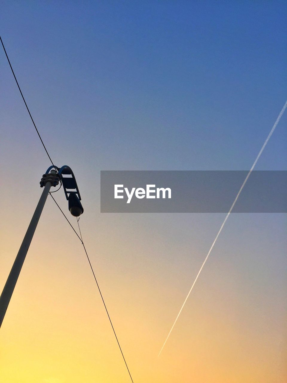 cable, low angle view, sunset, no people, clear sky, outdoors, nature, technology, electricity, vapor trail, sky, beauty in nature, contrail, day