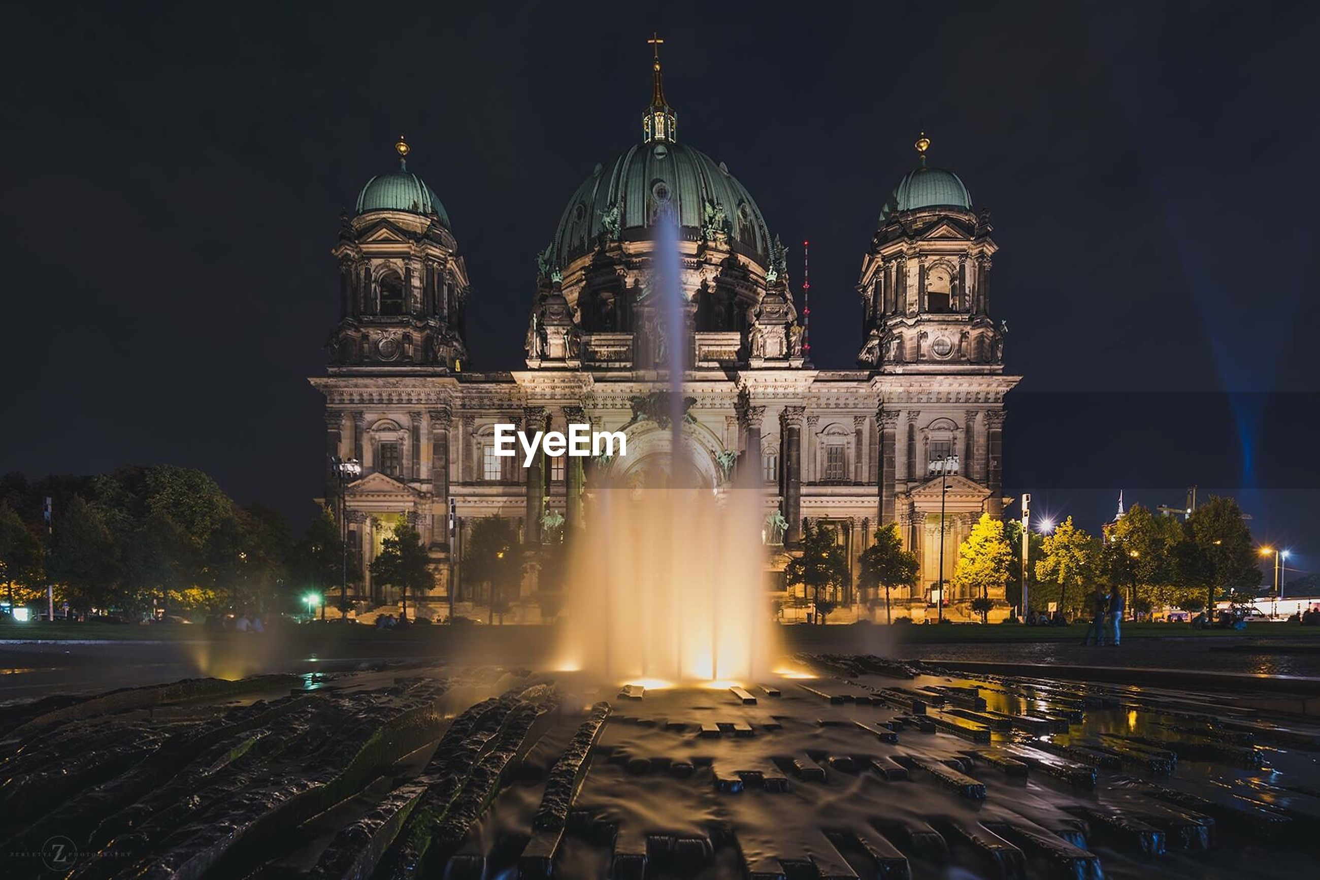 Fountain in front of berlin cathedral at night