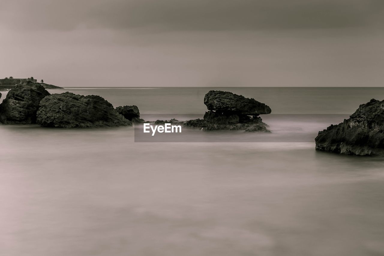 sea, sky, water, rock, beauty in nature, scenics - nature, tranquility, tranquil scene, rock - object, horizon over water, solid, nature, horizon, no people, idyllic, waterfront, land, long exposure, rock formation, stack rock