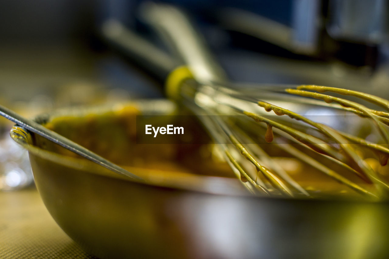 Close-up of wire whisk on bowl
