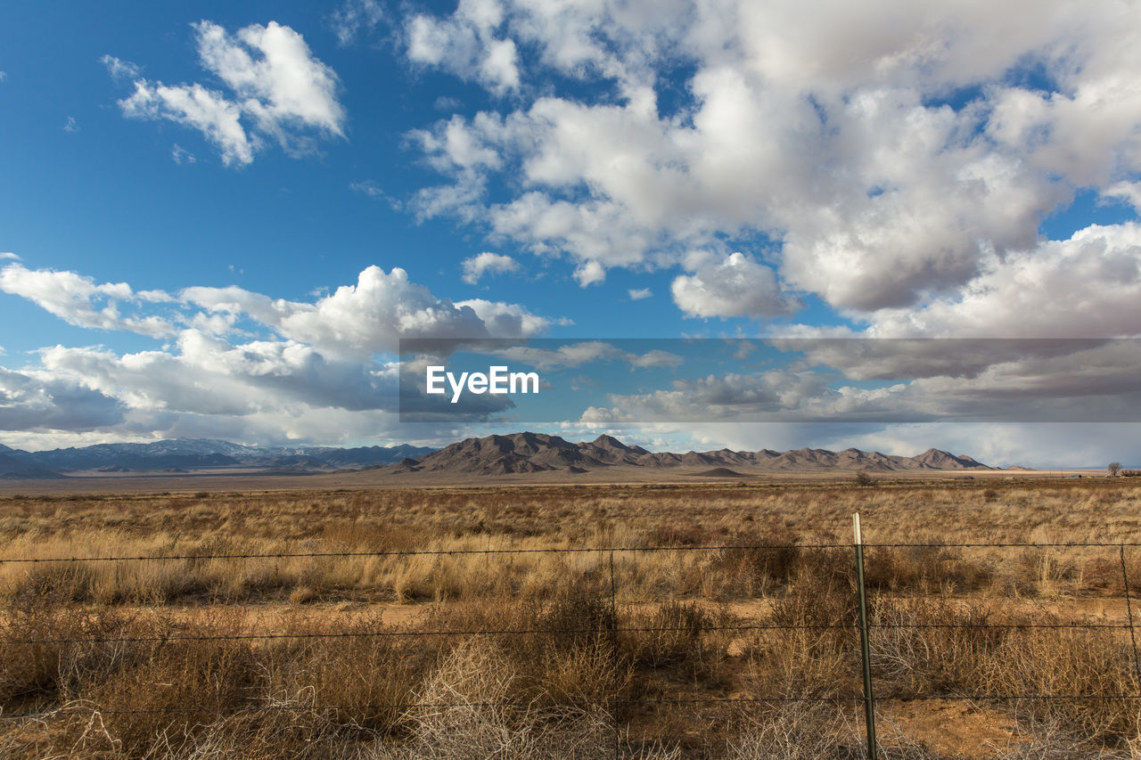cloud - sky, sky, landscape, scenics - nature, environment, tranquil scene, tranquility, non-urban scene, beauty in nature, land, nature, no people, day, field, mountain, plant, desert, grass, remote, idyllic, outdoors, arid climate, climate, semi-arid