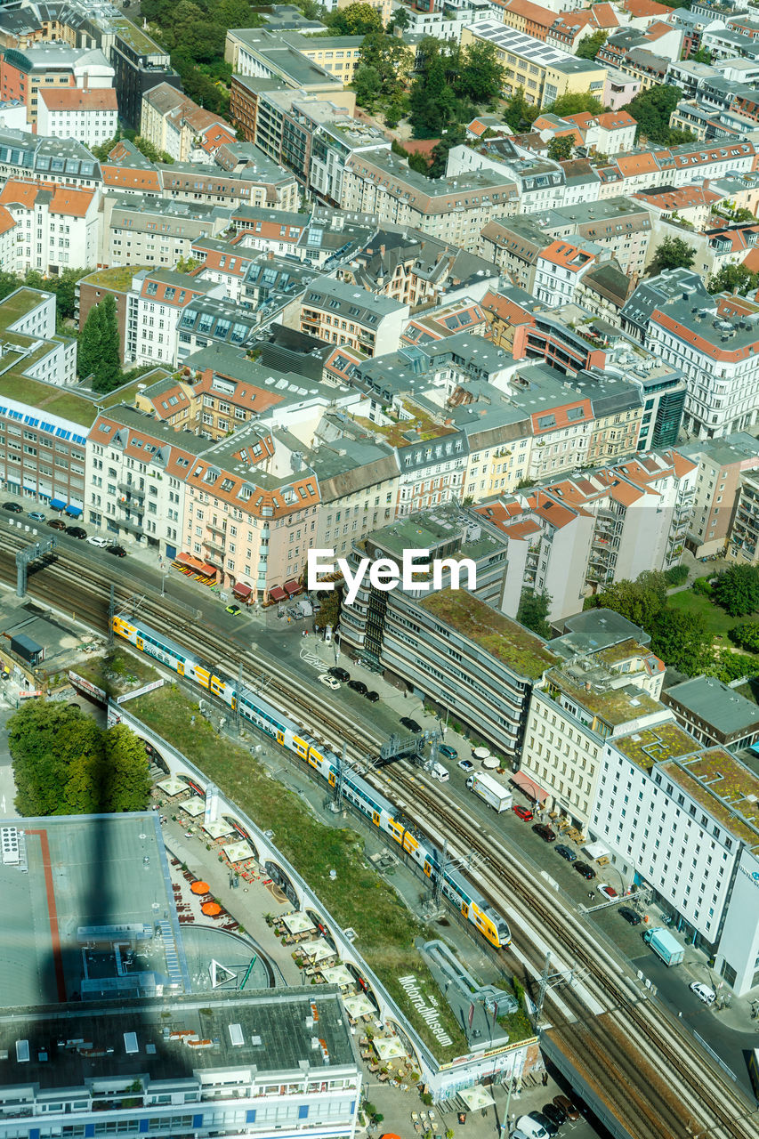 architecture, transportation, built structure, road, building exterior, high angle view, city, street, aerial view, outdoors, residential building, mode of transport, land vehicle, no people, day, cityscape
