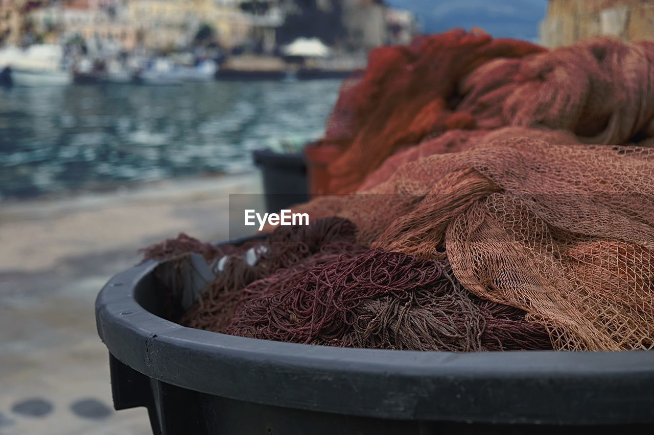 focus on foreground, close-up, day, water, no people, container, nature, fishing industry, outdoors, fishing, still life, fishing net, brown, beach, selective focus, large group of objects, industry, land, sea