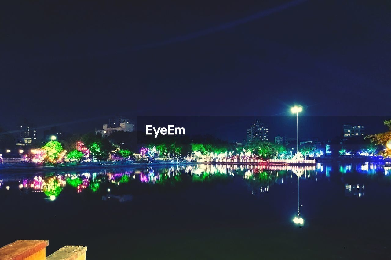 night, illuminated, water, lighting equipment, reflection, river, outdoors, waterfront, nautical vessel, sky, architecture, building exterior, bridge - man made structure, city, built structure, no people, nature, scenics, beauty in nature, clear sky, cityscape