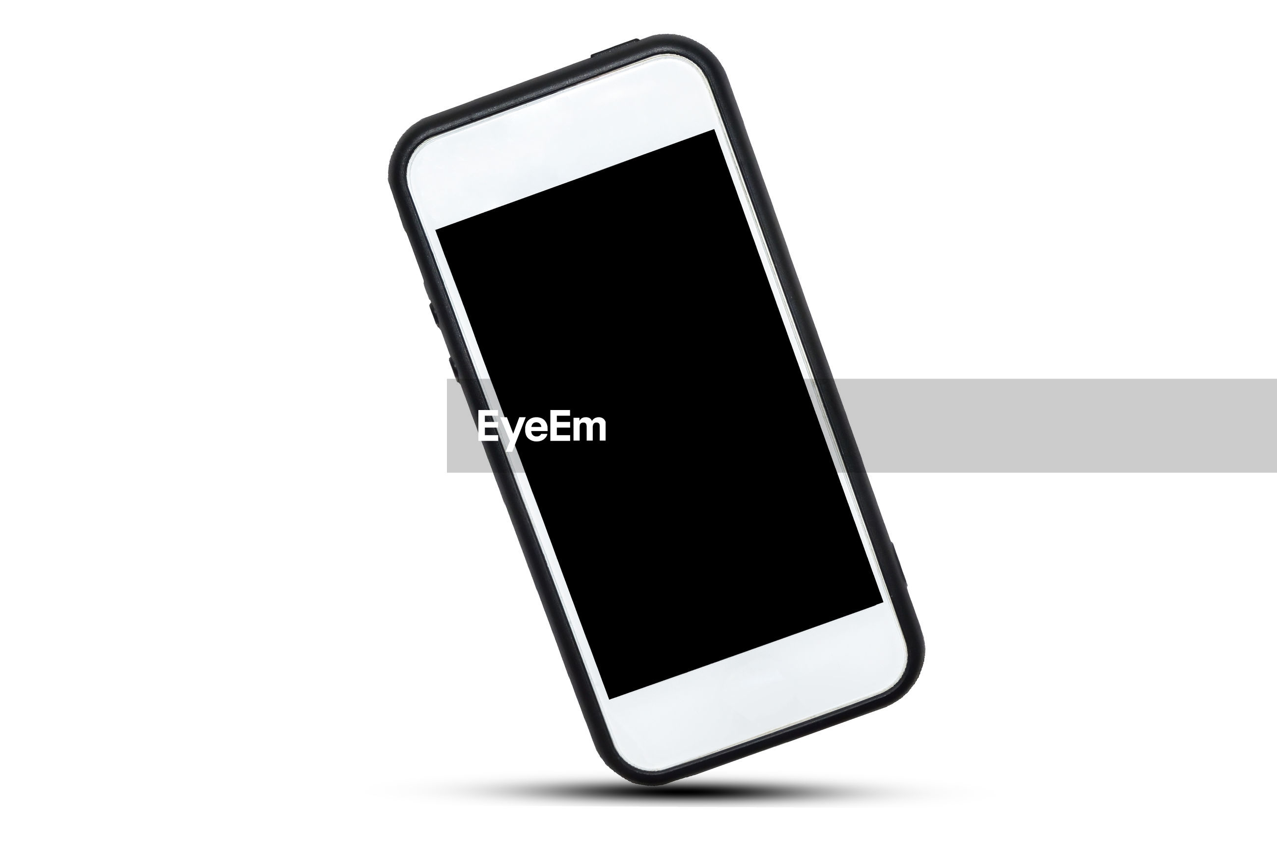 Close-up of mobile phone against white background