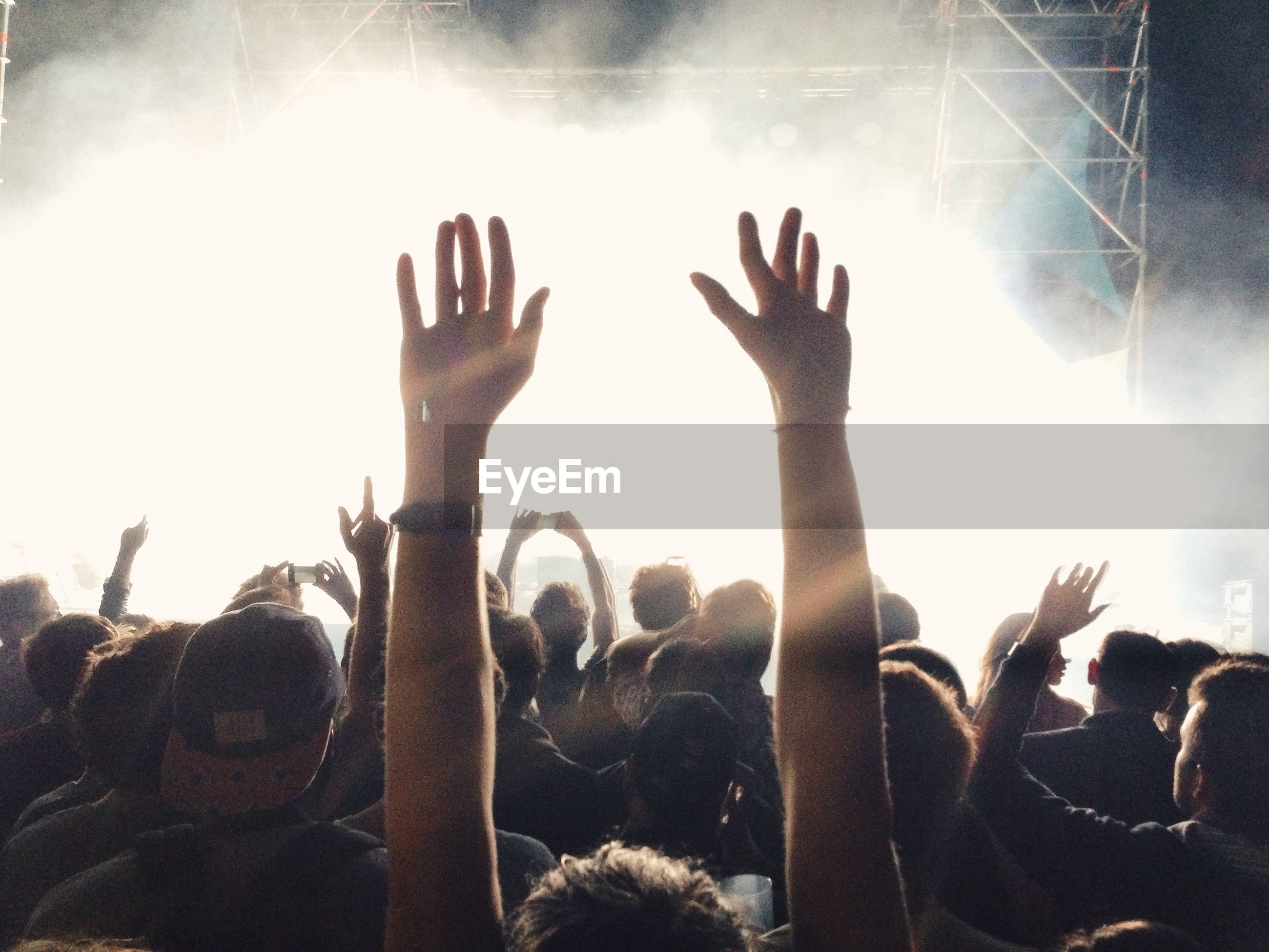 Crowd during music concert at night