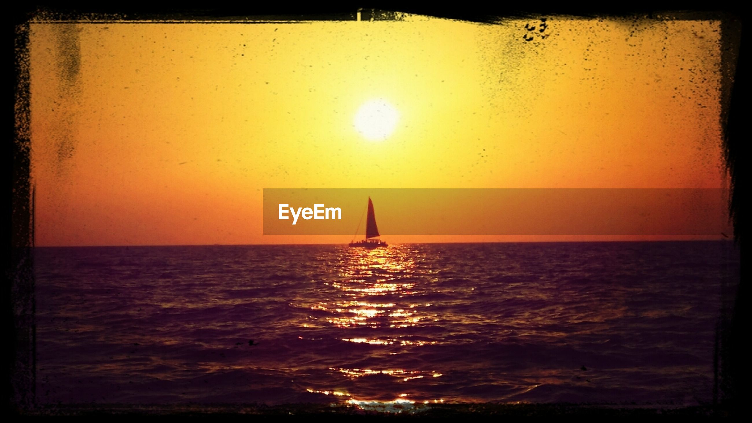 sea, water, horizon over water, sunset, transfer print, waterfront, sun, scenics, auto post production filter, beauty in nature, tranquil scene, nautical vessel, tranquility, orange color, transportation, rippled, sailing, sky, nature, sailboat