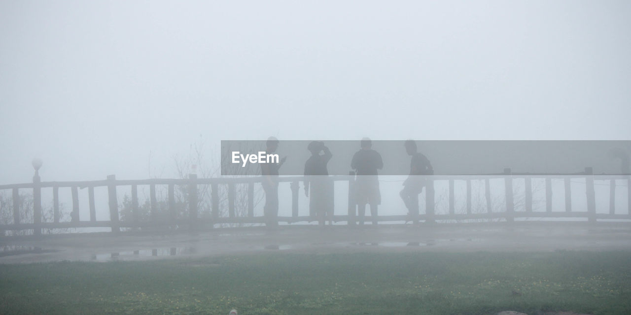 fog, foggy, mist, day, outdoors, hazy, nature, men, beauty in nature, sky, people