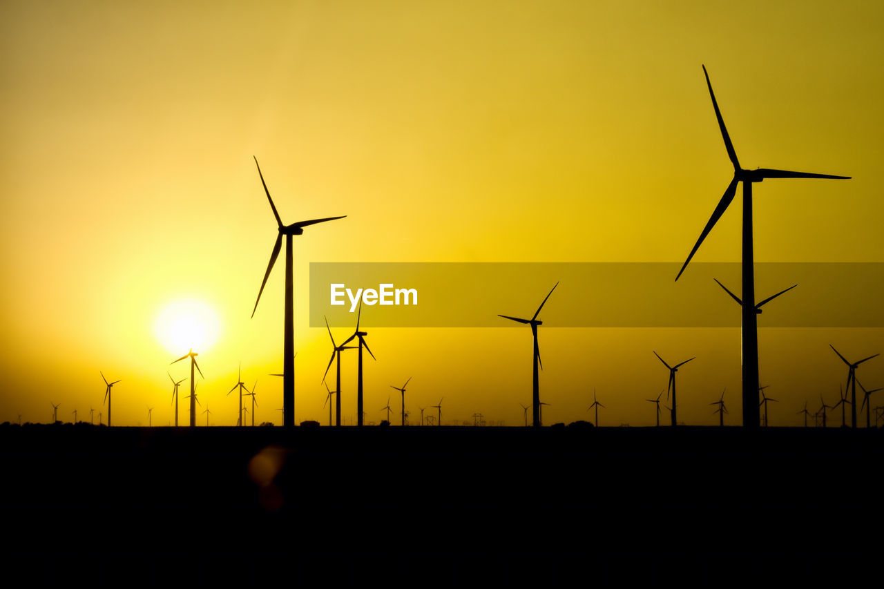 sunset, sky, fuel and power generation, turbine, environmental conservation, wind turbine, silhouette, renewable energy, wind power, alternative energy, environment, orange color, beauty in nature, nature, technology, no people, scenics - nature, field, landscape, land, outdoors, electricity, power supply, sustainable resources, clean