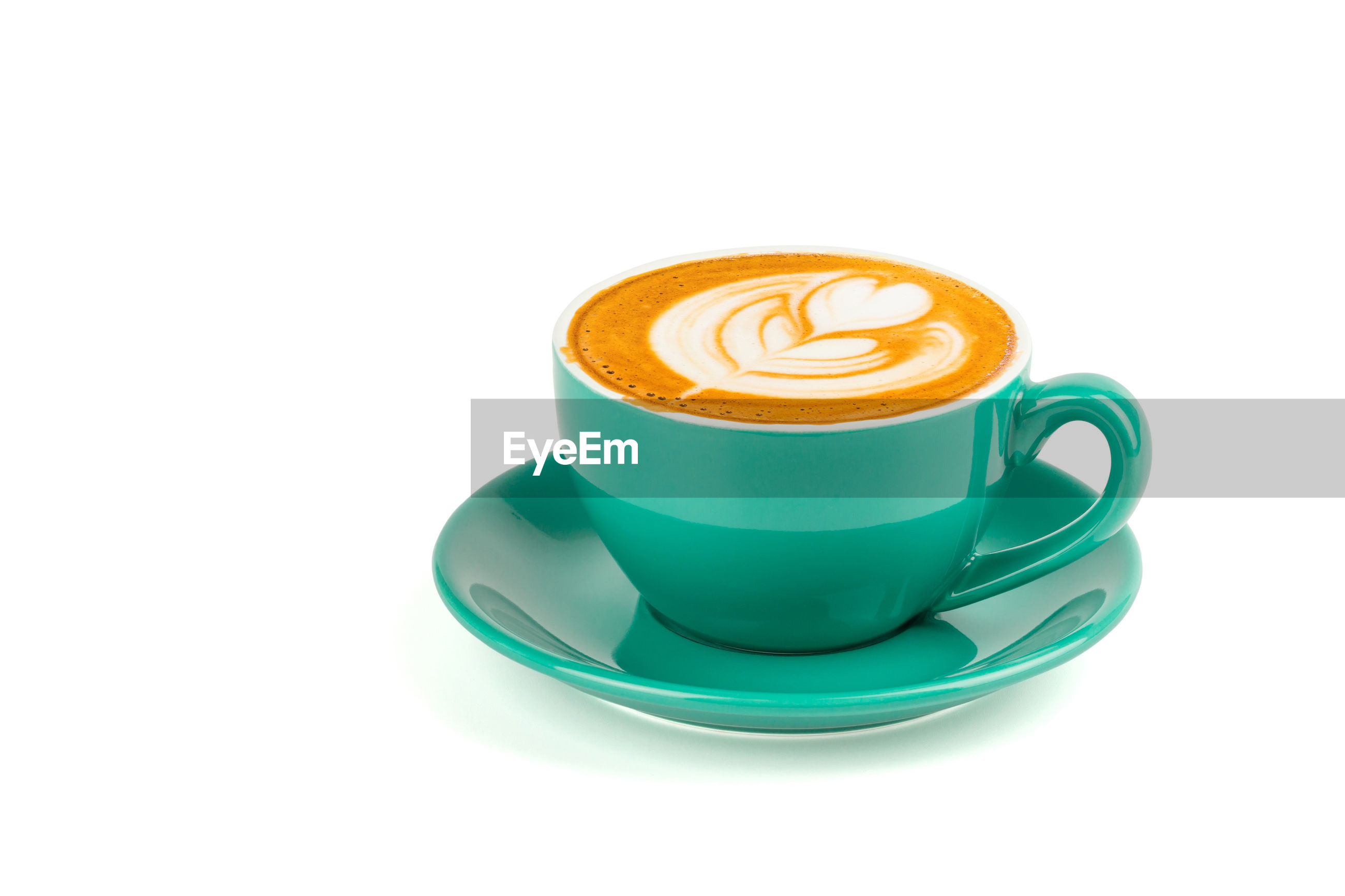 Close-up of cappuccino against white background