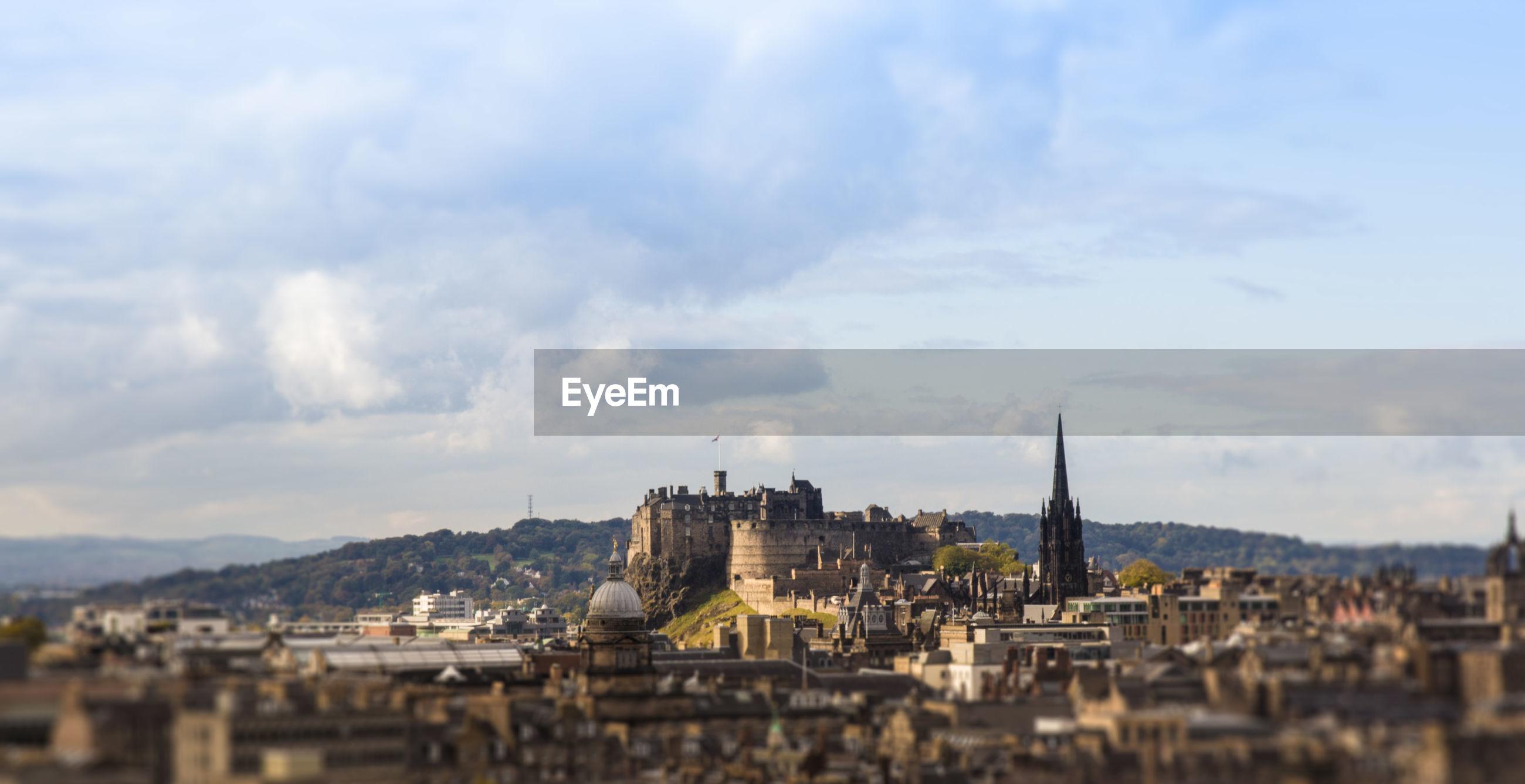 Edinburgh castle and town against sky