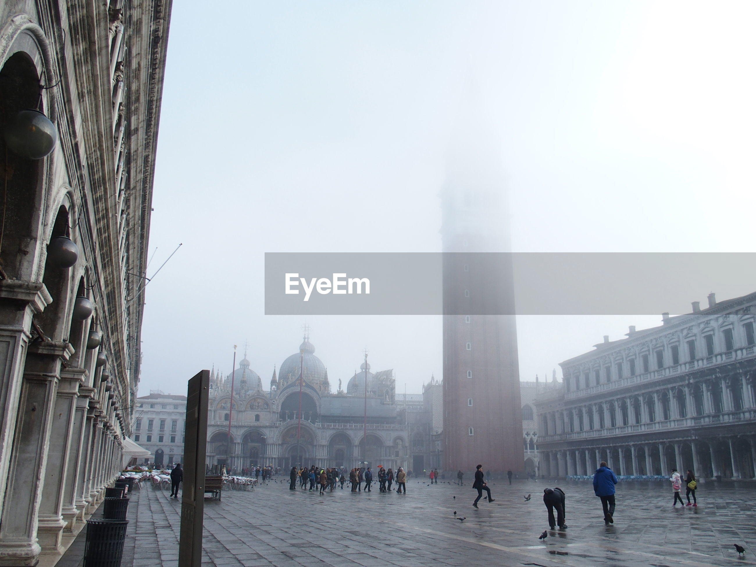 Tourists traveling at saint marks basilica in foggy weather