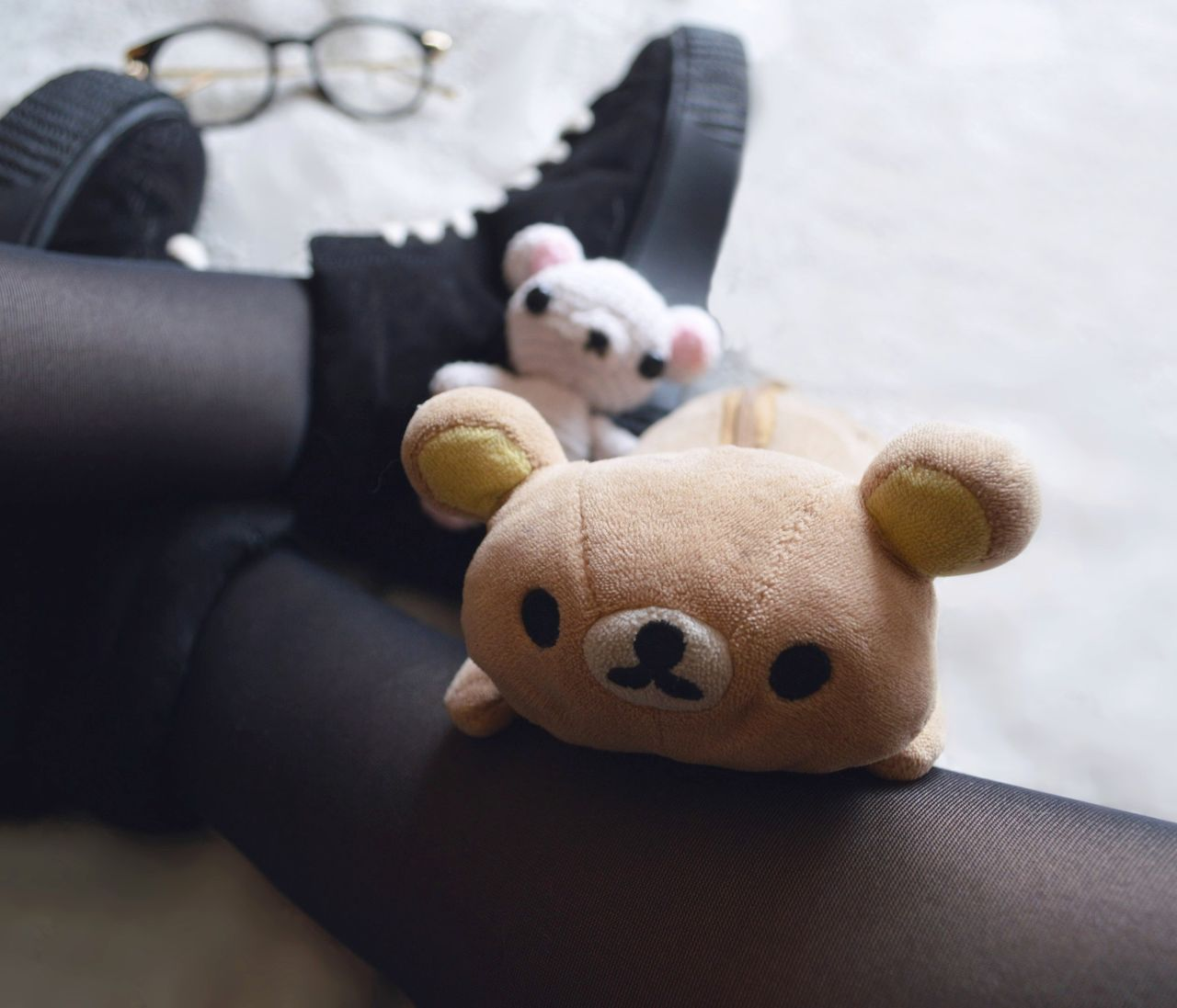 stuffed toy, toy, animal representation, teddy bear, close-up, indoors, human hand, real people, one person, childhood, human body part, panda, day, animal themes, mammal