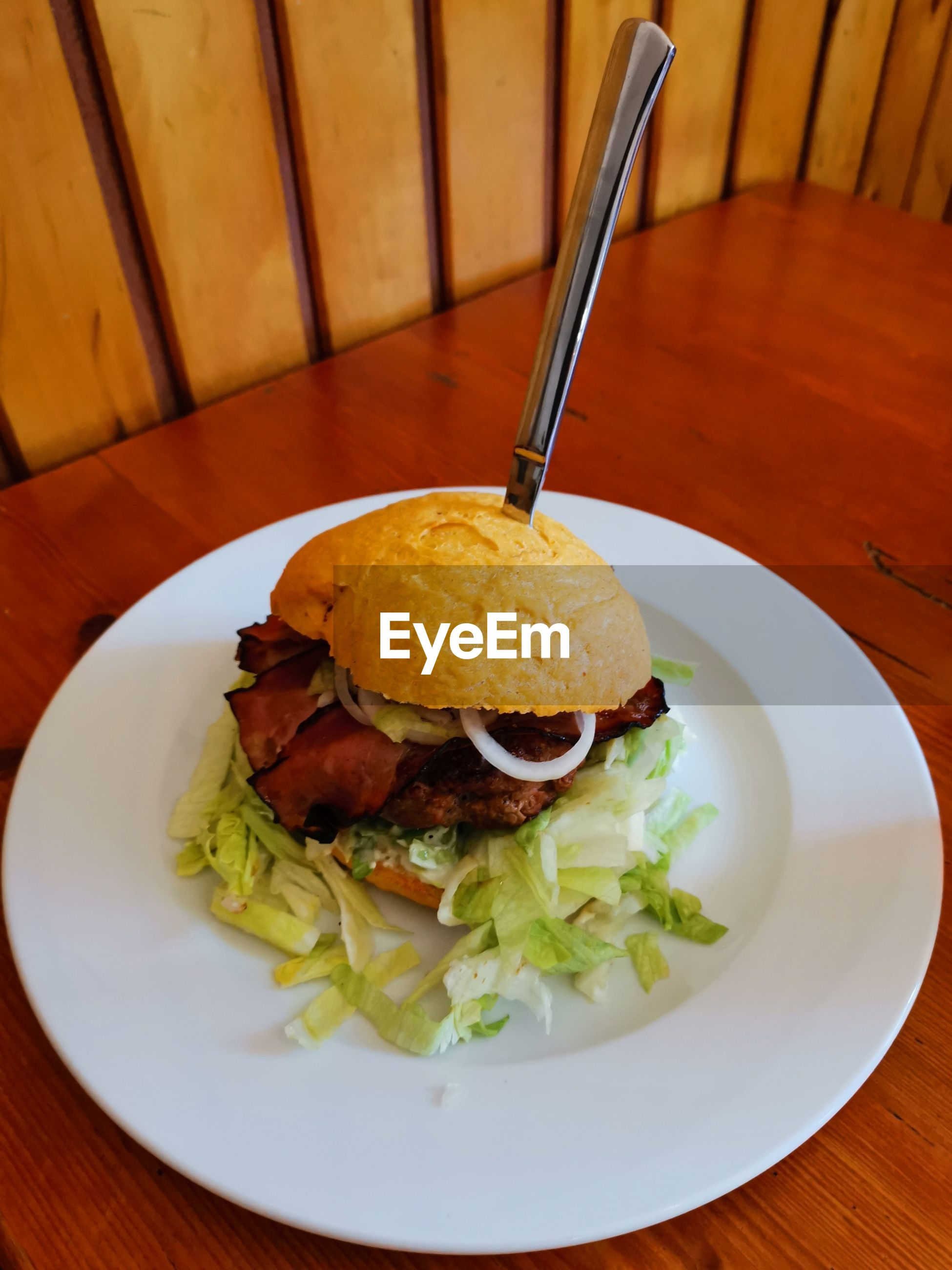 High angle view of hamburger in plate on table