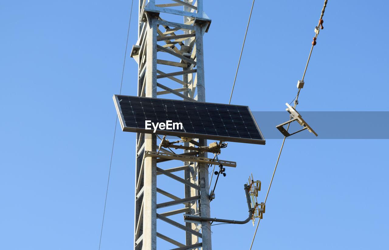alternative energy, fuel and power generation, renewable energy, solar panel, solar energy, environmental conservation, wind power, technology, wind turbine, electricity, power supply, clear sky, low angle view, blue, solar equipment, windmill, day, sustainable resources, outdoors, sunlight, traditional windmill, no people, industrial windmill, sky
