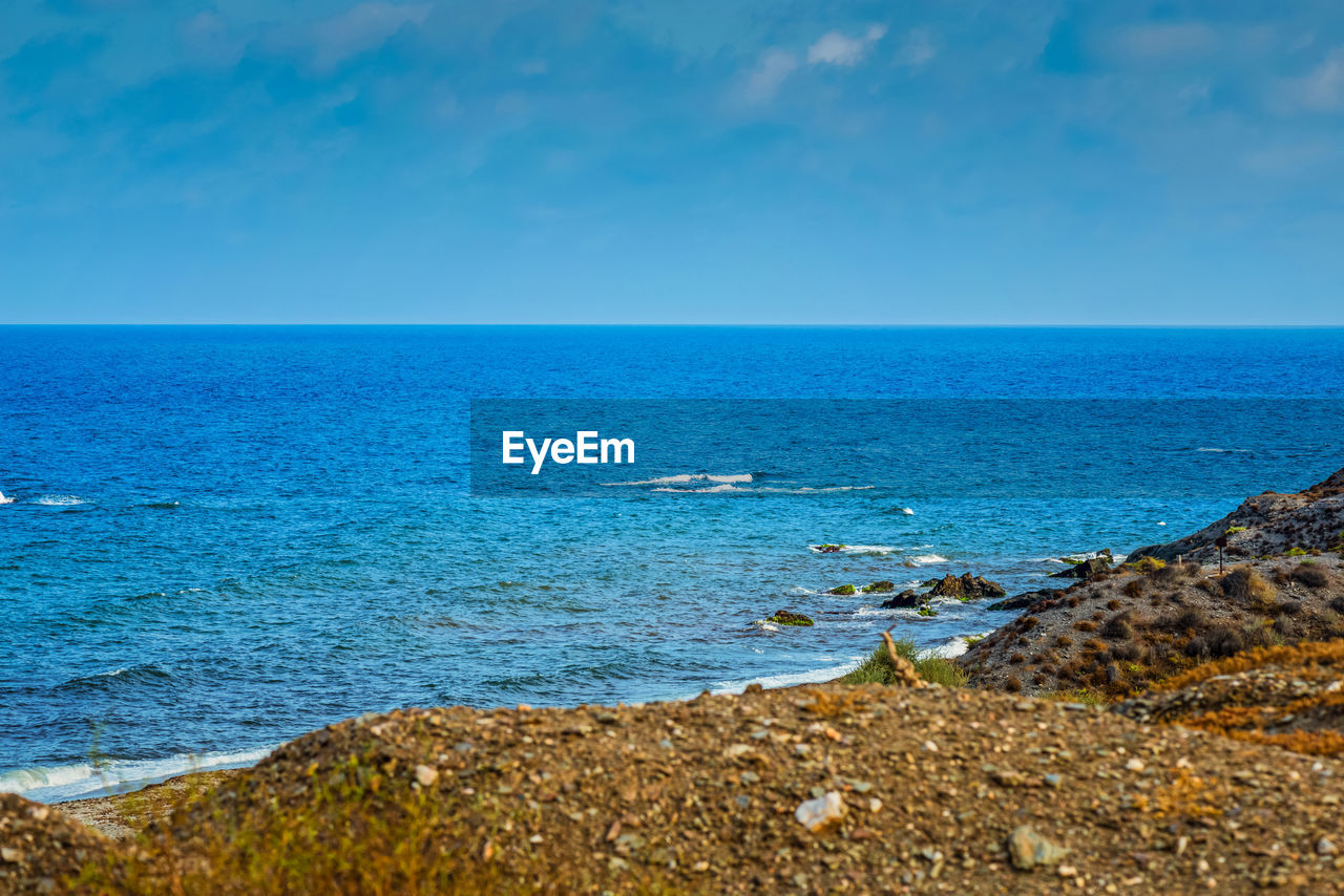 sea, sky, horizon, water, scenics - nature, horizon over water, beauty in nature, tranquility, tranquil scene, land, blue, idyllic, nature, beach, no people, day, non-urban scene, cloud - sky, rock, outdoors, turquoise colored