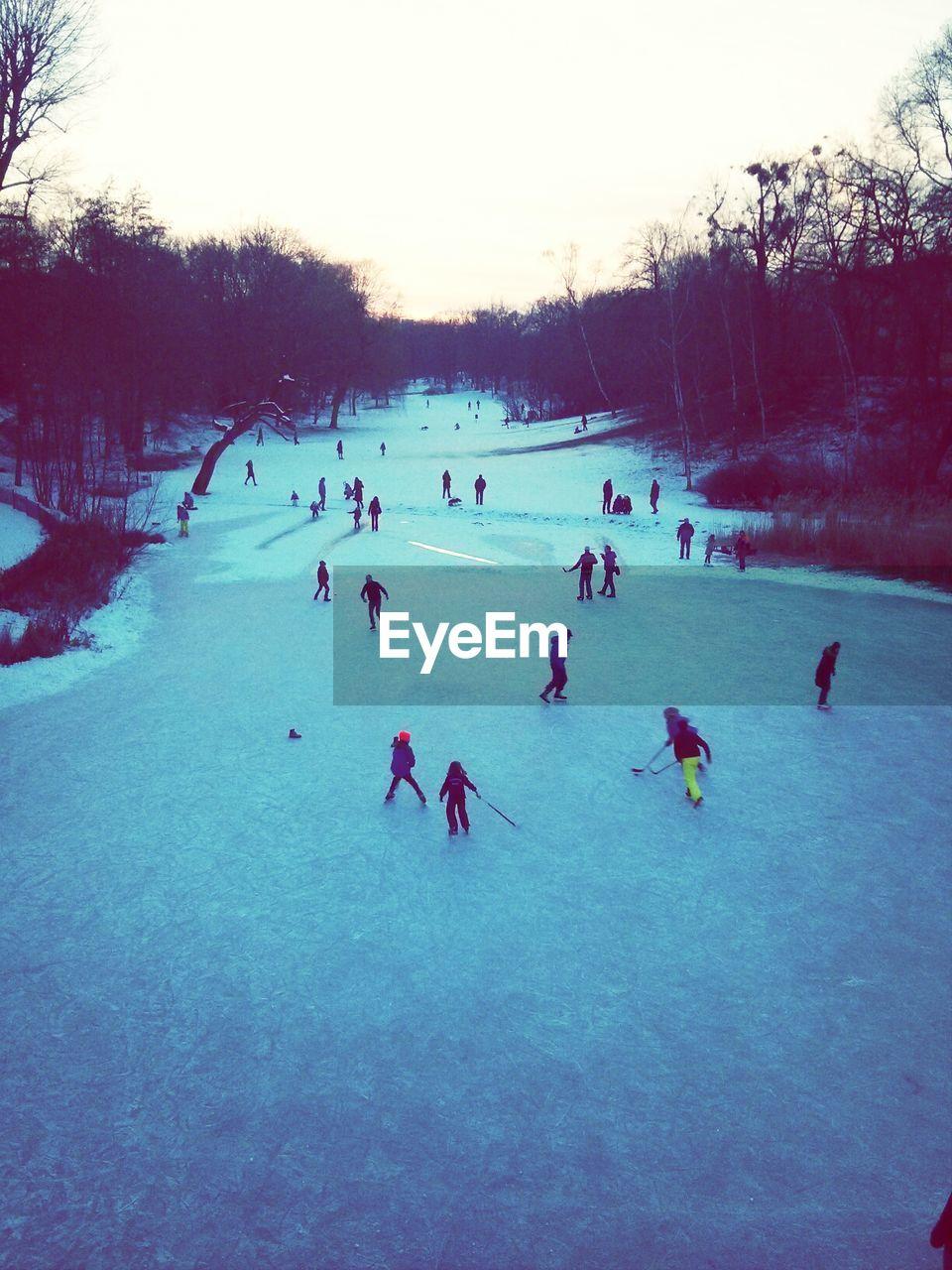 High angle view of people playing ice hockey