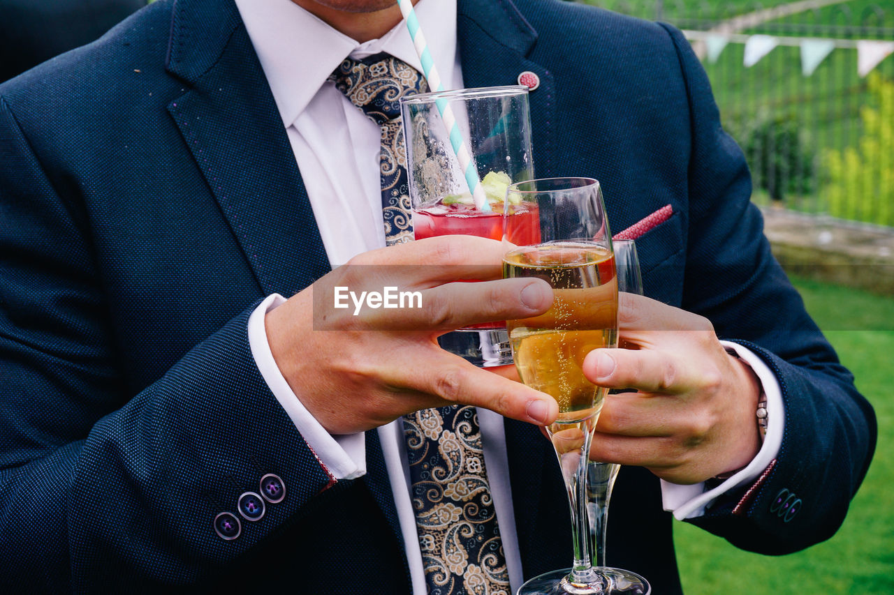 Close-up of man holding drinks