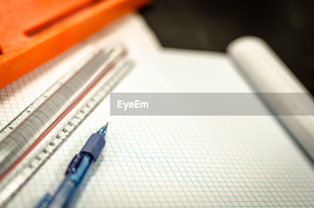 Close-up of pen on book