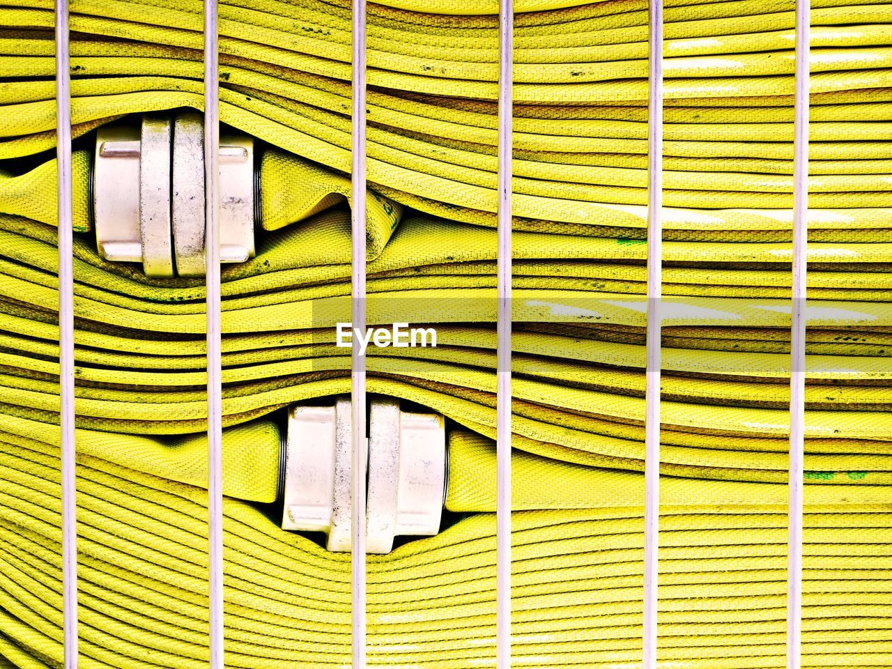 no people, full frame, pattern, close-up, green color, yellow, metal, wall - building feature, day, mailbox, indoors, built structure, backgrounds, architecture, protection, hygiene, connection, hanging, clothing, corrugated