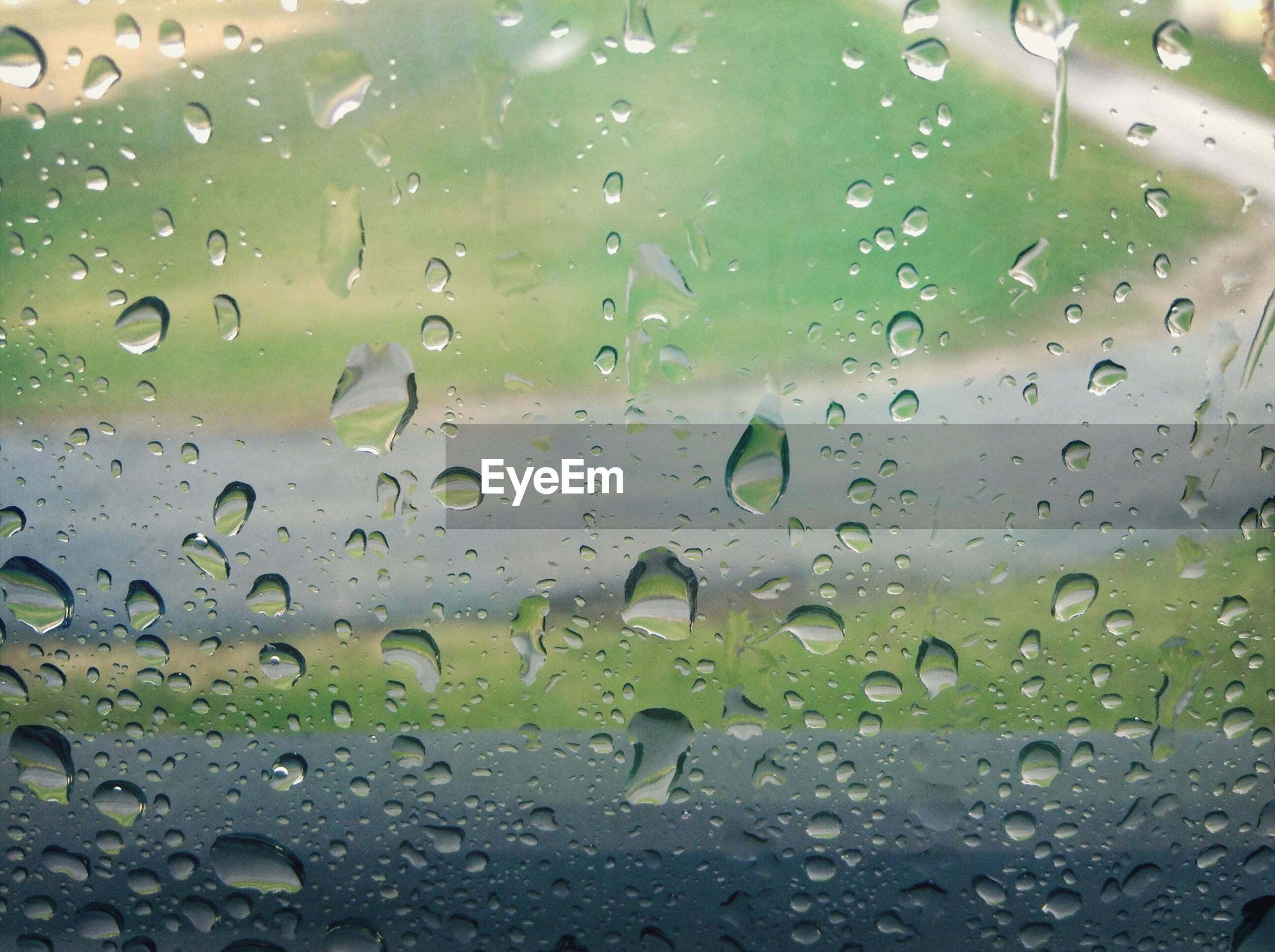 drop, wet, window, glass - material, transparent, indoors, water, rain, full frame, raindrop, backgrounds, glass, close-up, weather, focus on foreground, season, droplet, no people, water drop, day