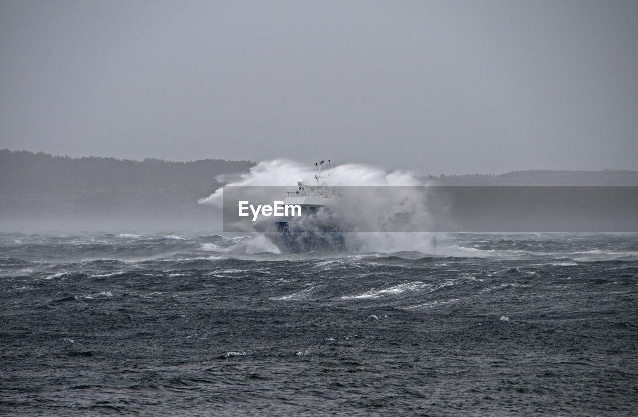 Sailboat Splashing Water On Sea