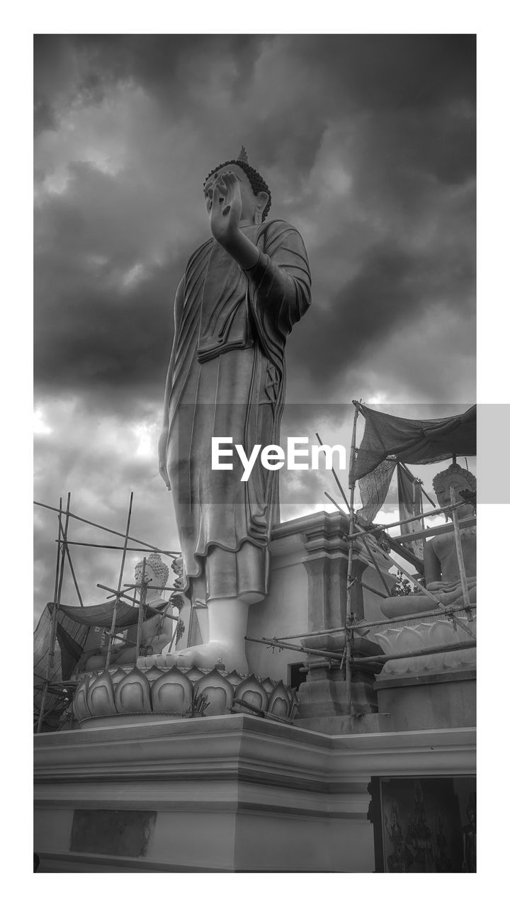 sky, cloud - sky, human representation, statue, sculpture, representation, auto post production filter, transfer print, male likeness, low angle view, art and craft, architecture, nature, built structure, creativity, day, building exterior, no people, craft, female likeness