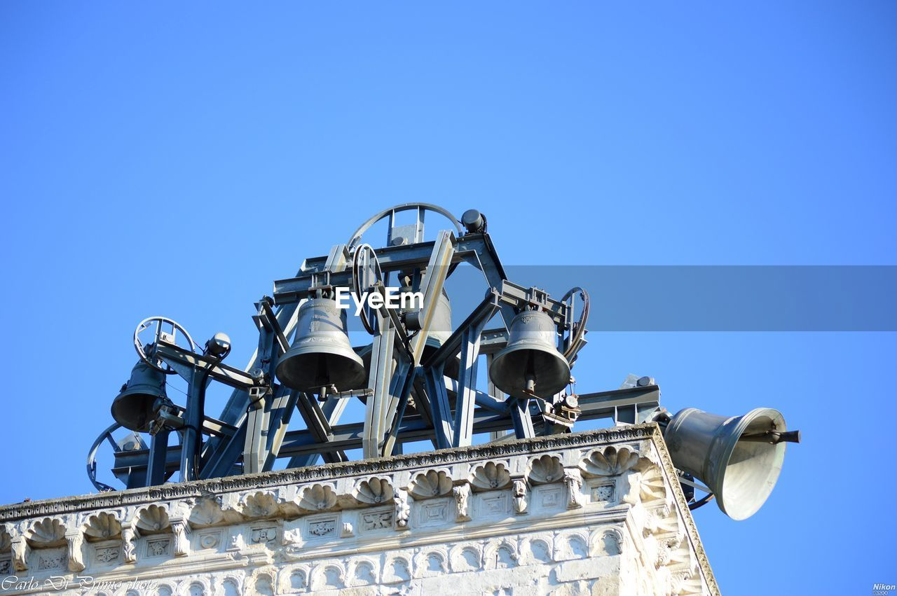 sky, blue, low angle view, clear sky, copy space, nature, day, no people, metal, built structure, architecture, outdoors, building exterior, industry, sunlight, technology, factory, travel, tourism, travel destinations