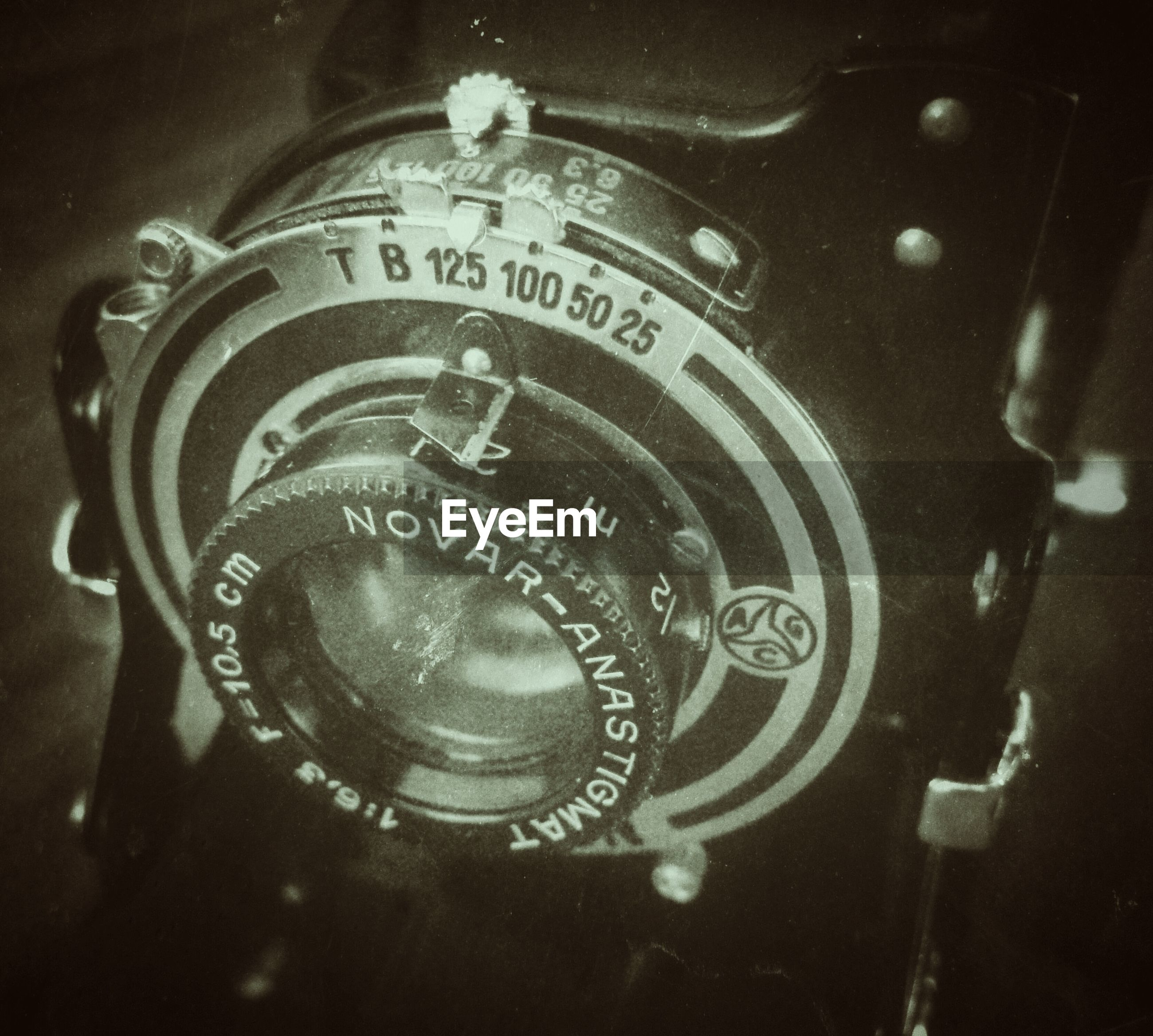 text, indoors, communication, close-up, number, western script, metal, technology, time, clock, single object, old-fashioned, retro styled, no people, old, high angle view, accuracy, focus on foreground, history, antique