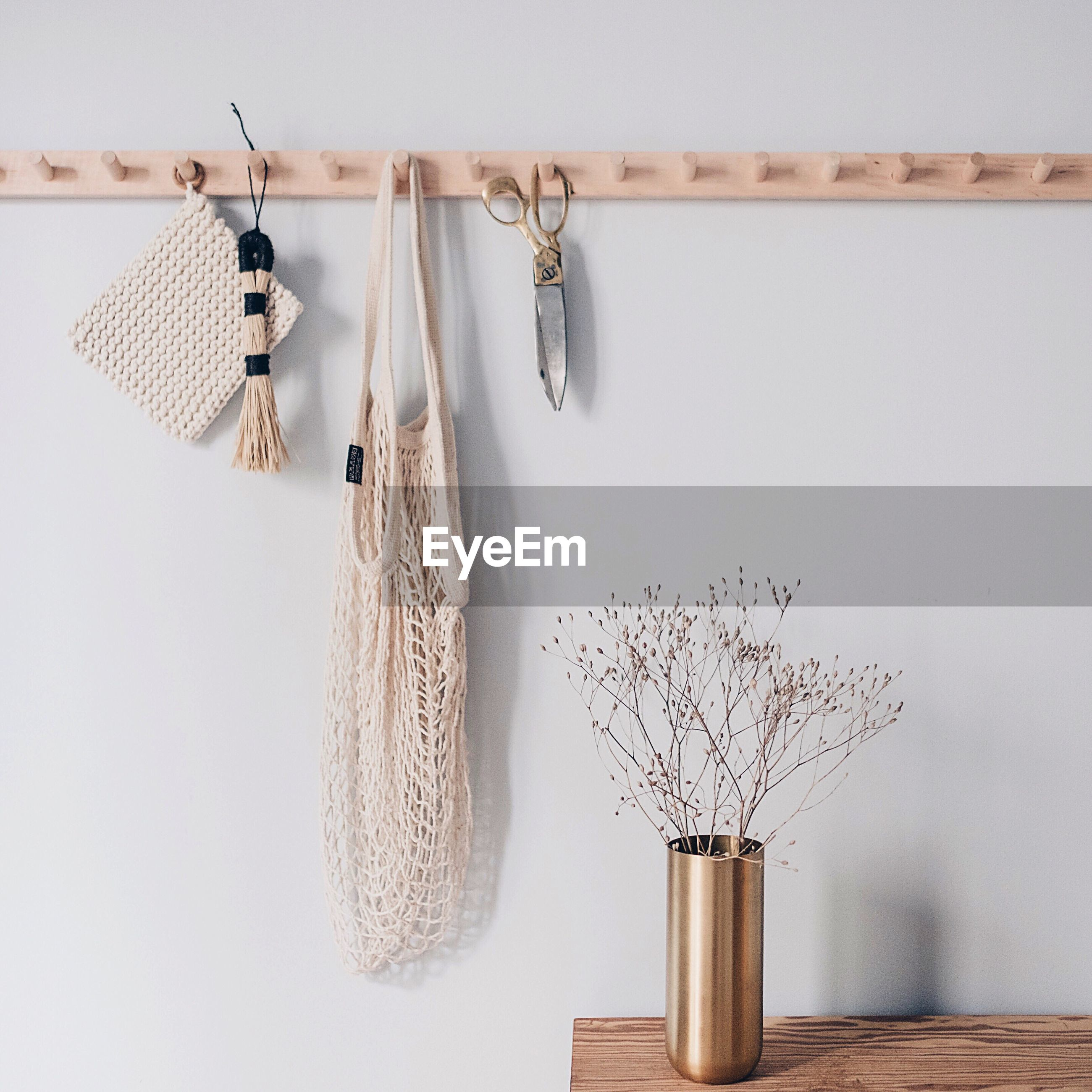 Clothes hanging on wood
