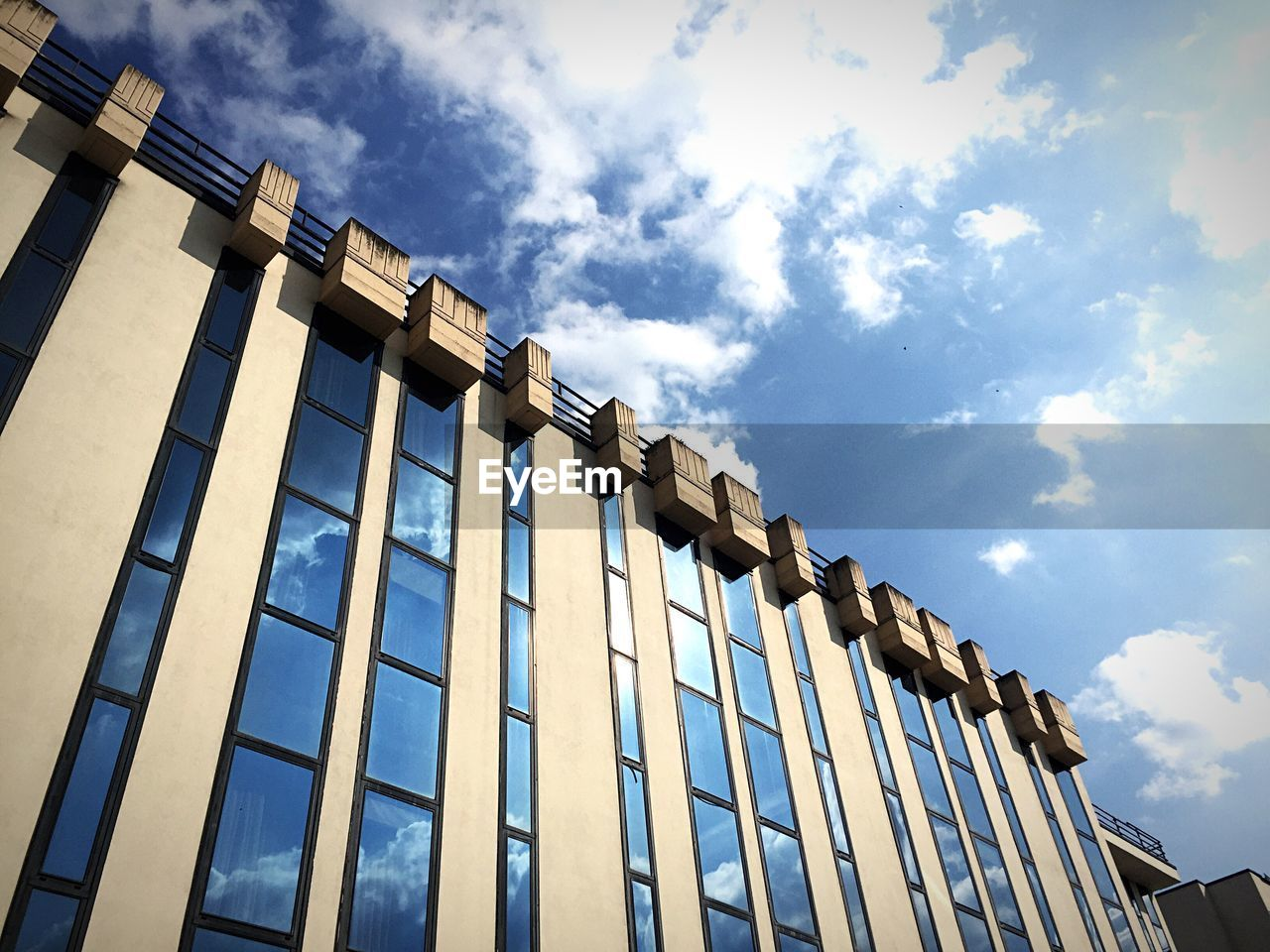 low angle view, architecture, building exterior, sky, built structure, cloud - sky, outdoors, day, no people
