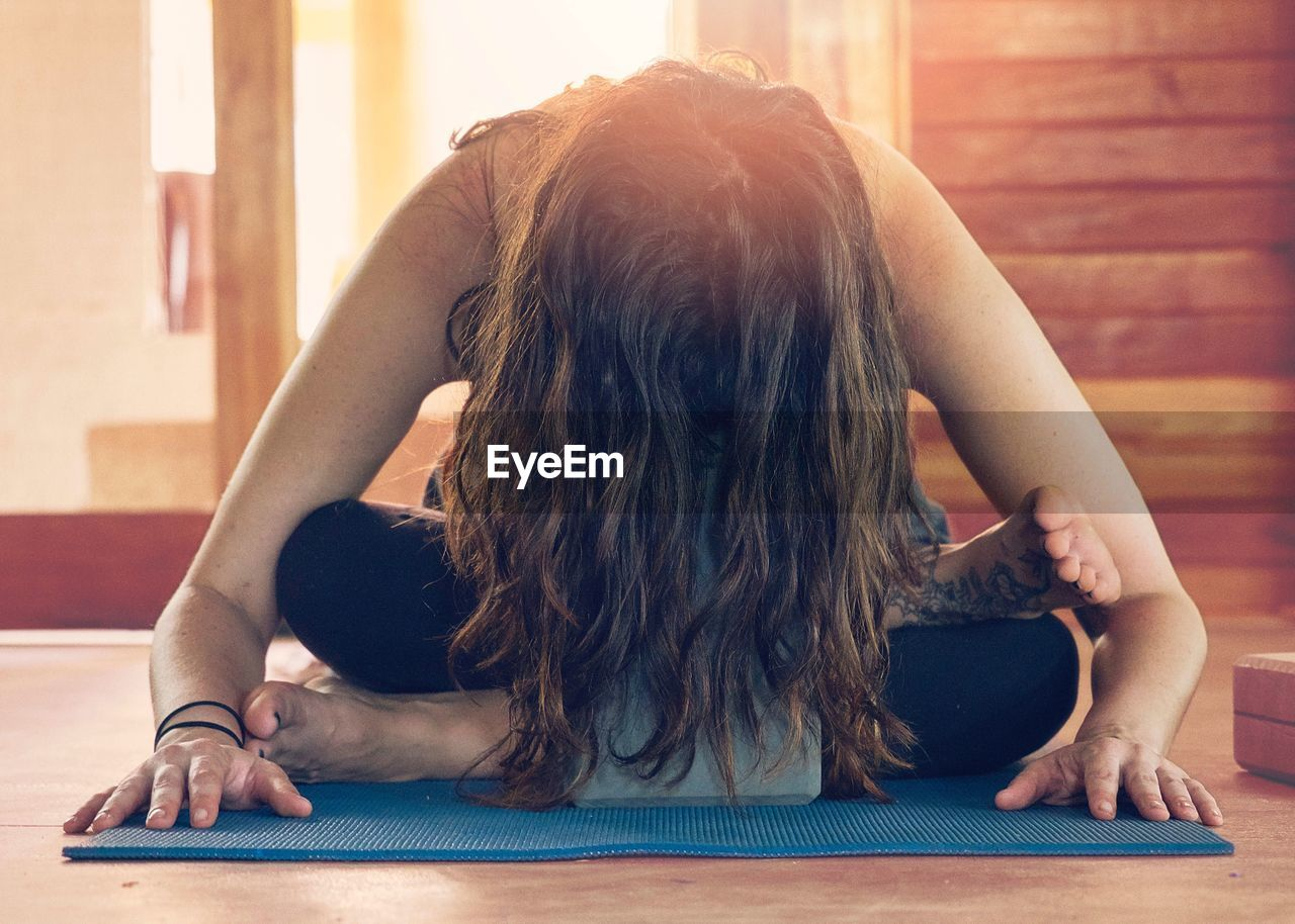 Woman With Long Hair Doing Yoga At Home