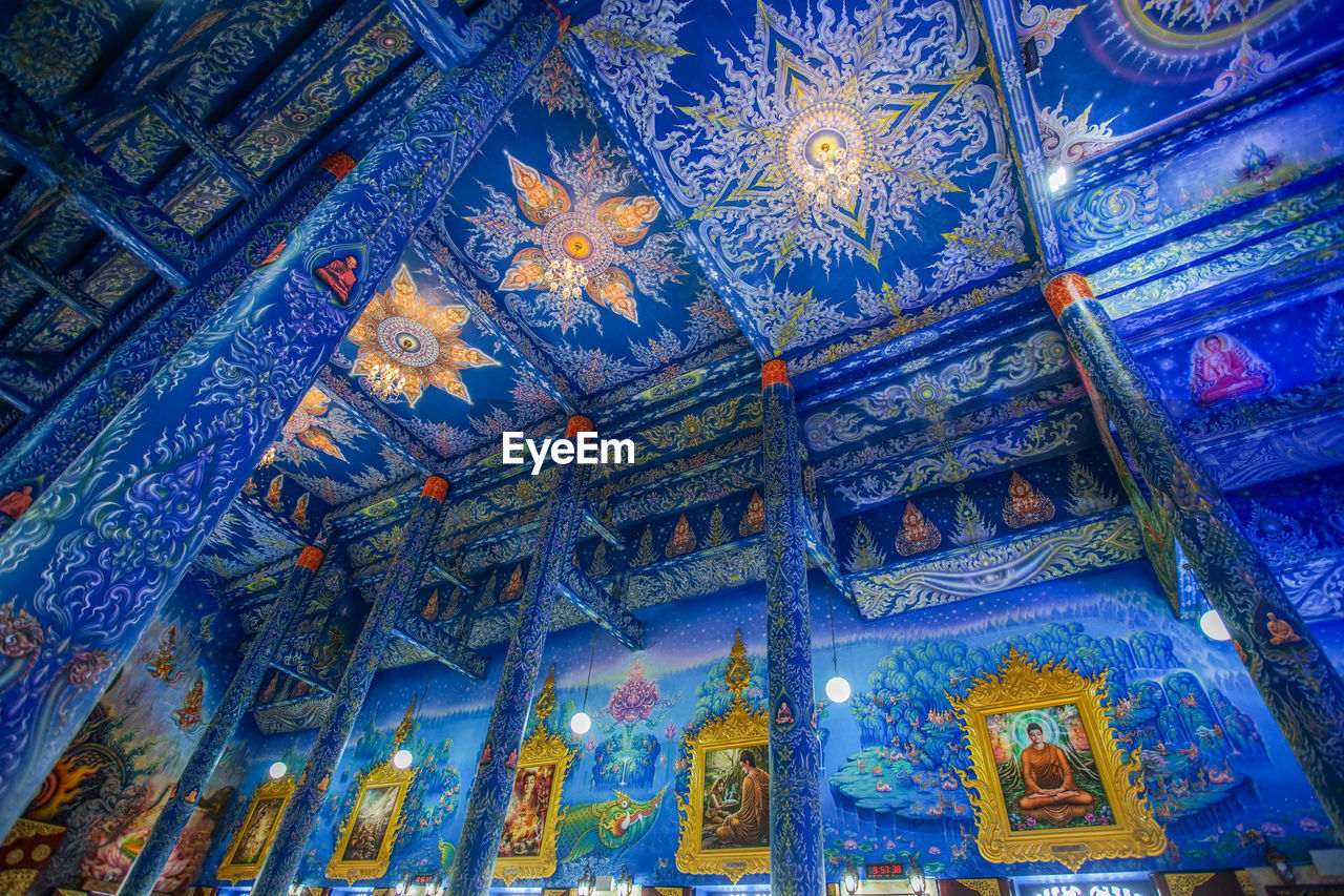 low angle view, religion, belief, built structure, place of worship, spirituality, pattern, architecture, no people, art and craft, creativity, building, indoors, design, craft, blue, decoration, human representation, ceiling, ornate, mural, floral pattern, architecture and art