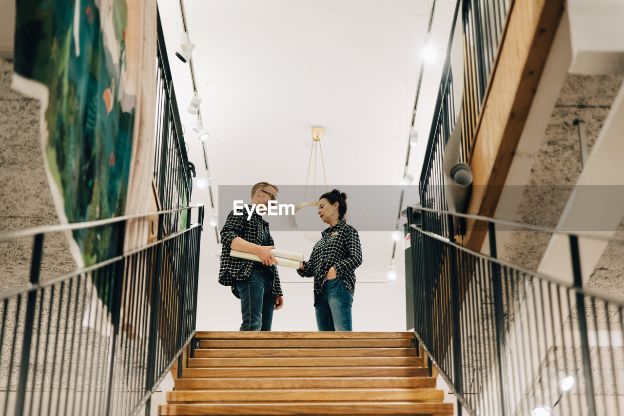 MEN STANDING ON STAIRCASE