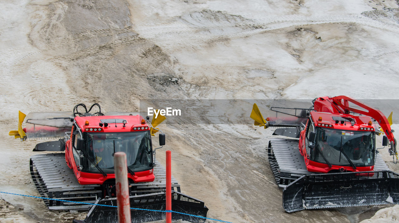 High Angle View Of Construction Vehicles On Field