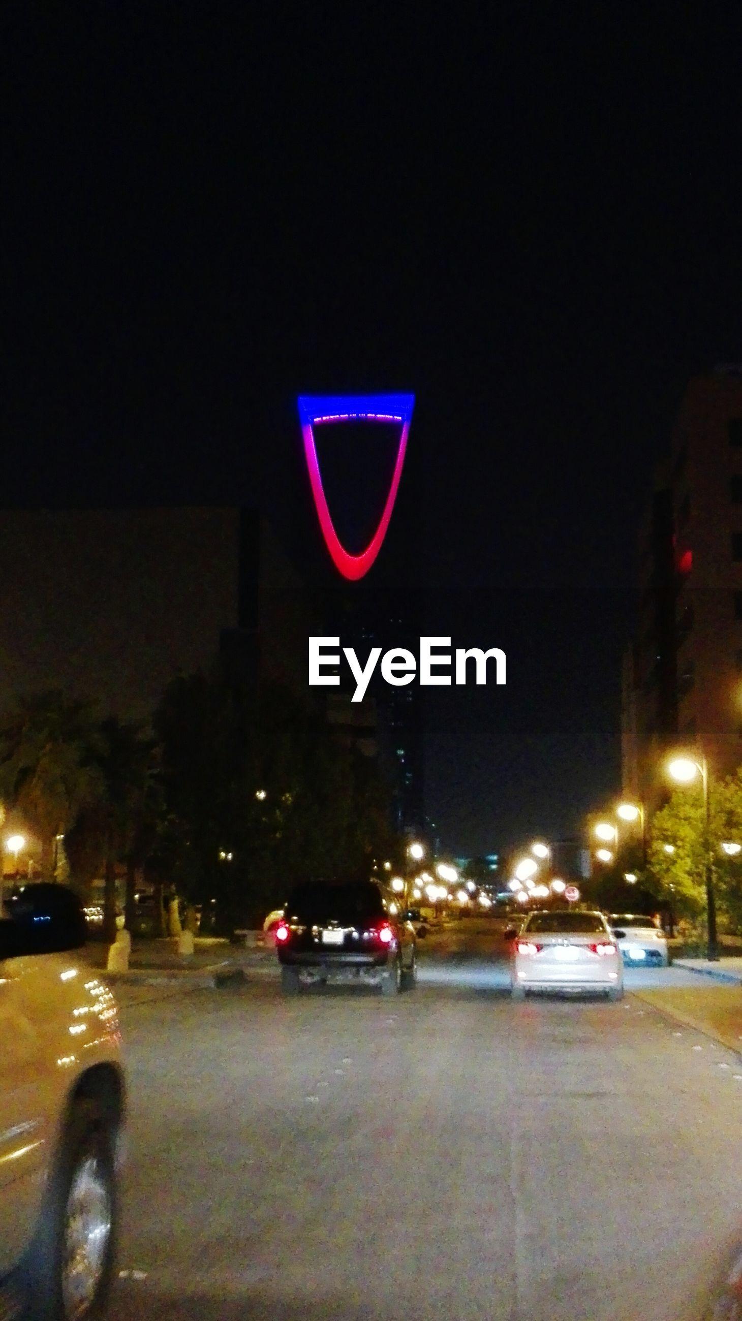 transportation, night, illuminated, land vehicle, mode of transport, road, traffic, motion, city, red, headlight, no people, city street, outdoors, city life, sky